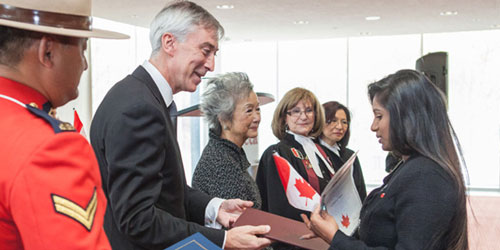 President David Agnew and Rt. Honourable Adrienne Clarkson congratulating new Canadians
