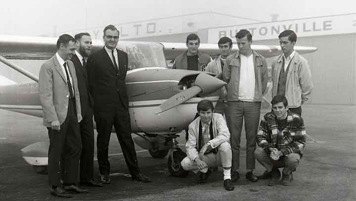 Flight students pose with former Seneca president William T. Newnham at Buttonville Airport in October 1968.