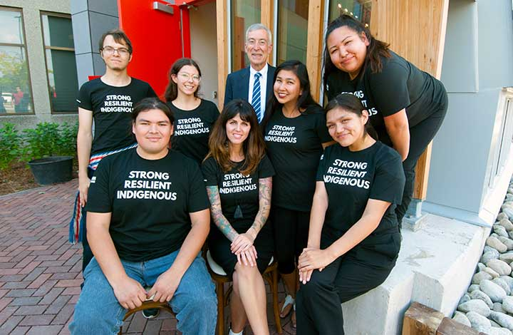 President David Agnew (centre) is pictured in front of Odeyto with Indigenous students